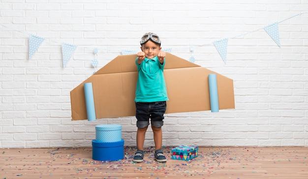 Boy playing at being aviator