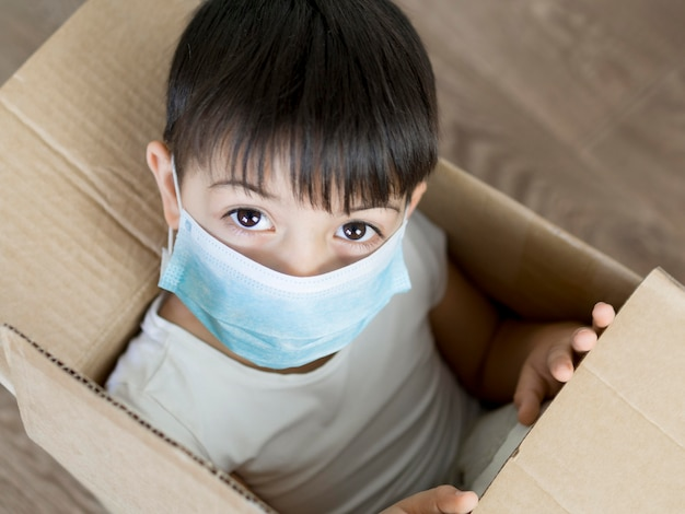 Boy playing in cartoon box