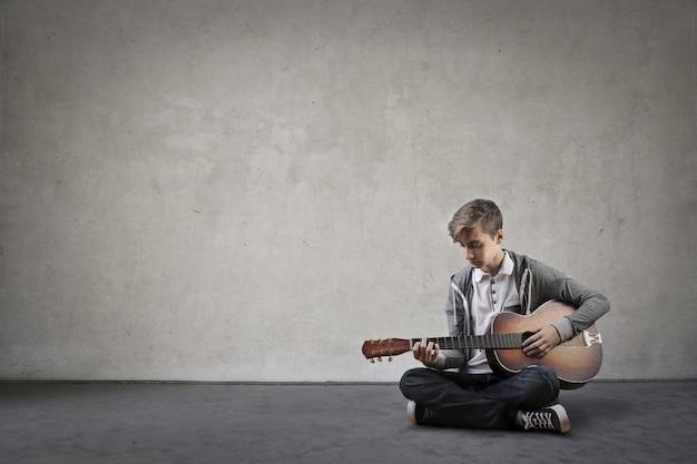 Boy playing to music