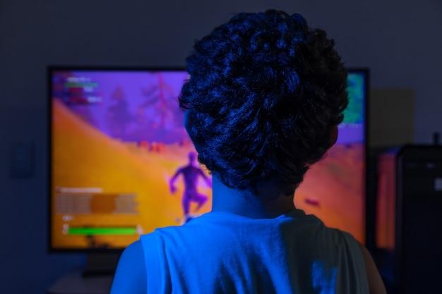Boy playing video game at night