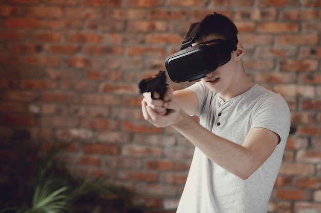 Boy playing with vr headset at home