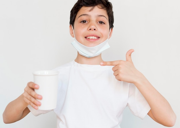 Boy pointing at tea cup