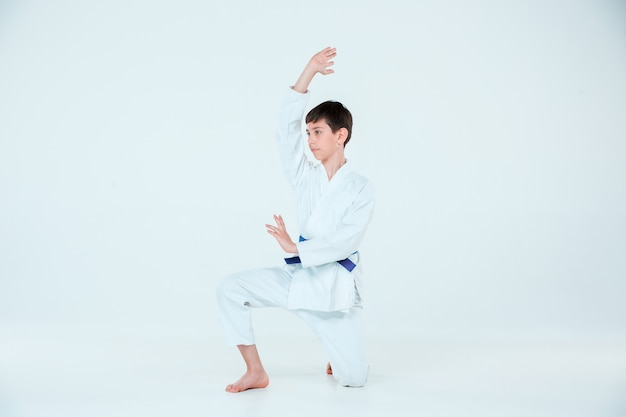 Boy posing at aikido training in martial arts school. healthy lifestyle and sports concept