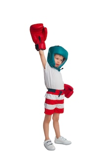 Boy posing in a boxing outfit isolated on a white surface
