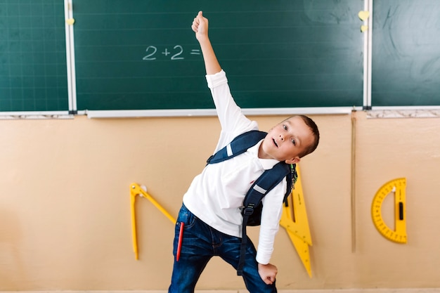 Boy posing in mathematics class
