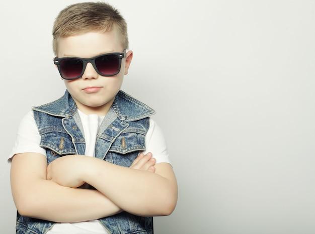 Boy posing in studio, happy child