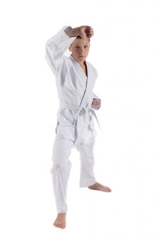 Boy posing with karate techniques  on white isolated