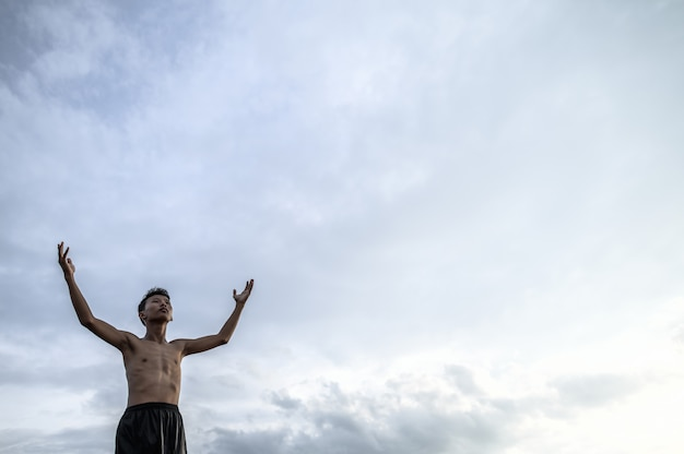 The boy raised his hand to the sky to ask for rain, global warming and water crisis