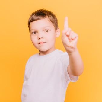 Boy raising finger