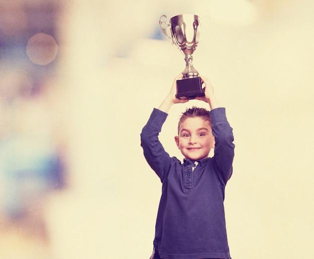 Boy raising his trophy