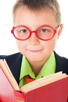 Boy reading a book thirsty for knowledge  isolated