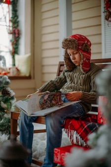 Boy reads a book in christmas