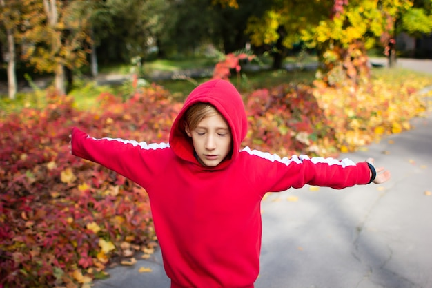 A boy in a red jacket