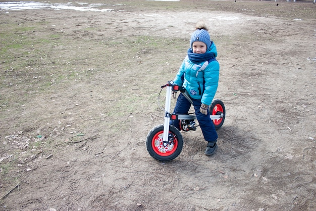 Boy riding a bicycle in the stadium. bicycle with inflatable wheels.