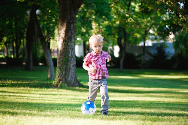 Boy running towards ball on the field