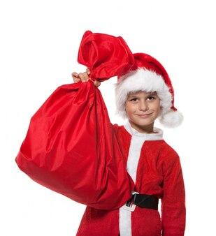 袋を持って少年サンタクロース