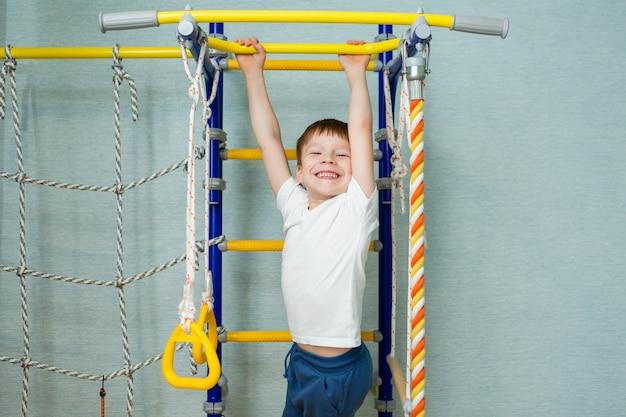 Boy schoolboy understates sports on swedish house wall
