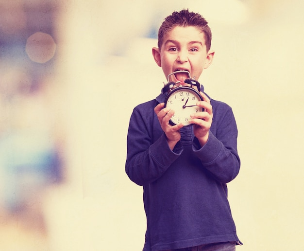 Boy screaming with a clock