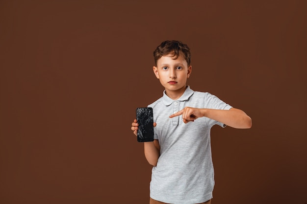 Boy in shock because he accidentally spoiled the smartphone
