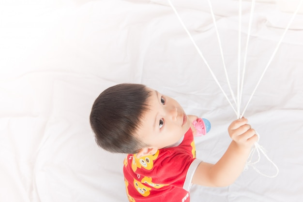Boy sibling with balloon heart shape of love