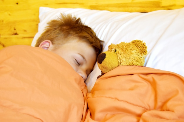 Boy sleeping with a toy