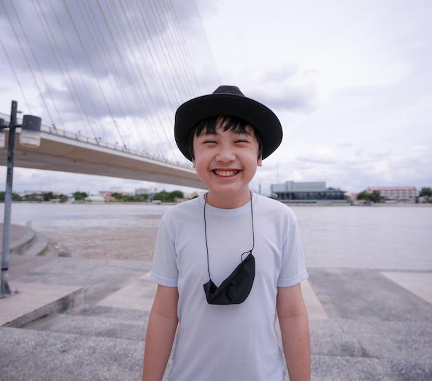 Boy smiling and wearing black hat
