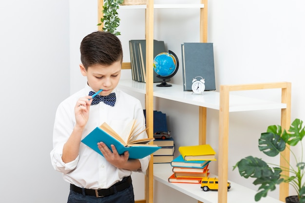 Boy standing while reading