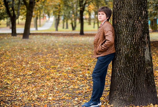 Boy teenager in autumn forest