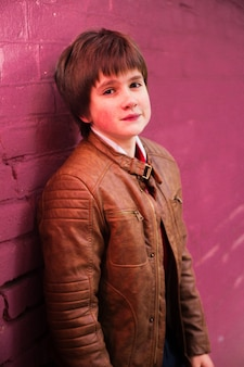 Boy teenager posing against a brick wall background