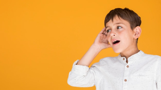 Boy trying to understand something with copy space