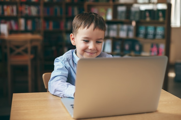 Boy typing on the laptop