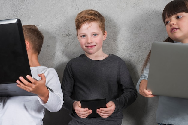 Boy using electronic devices