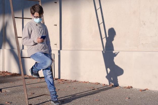 Boy using mobile phone