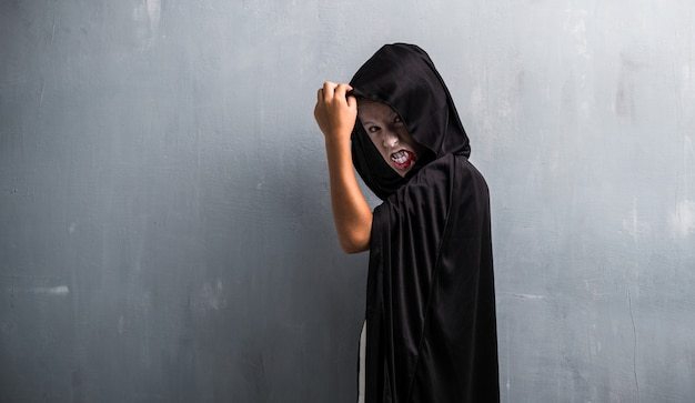 Boy in vampire costume for halloween holidays