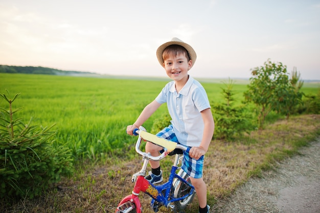 Boy wear hat in bicycle, happy children moments.
