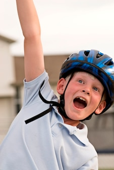 Boy wearing bicycle helmet, close-up