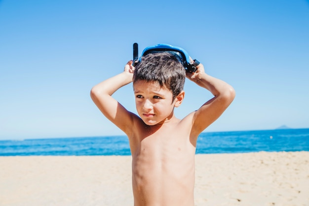 Boy wearing diving goggles