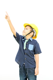 A boy wearing a helmet is pointing his hand isolated on white background
