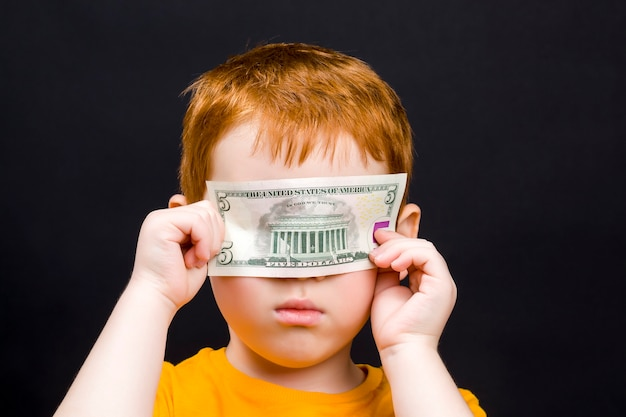 Boy with american dollar