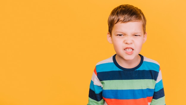 Boy with angry expression