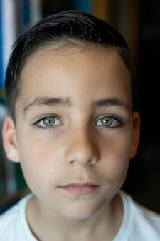Boy with beautiful green eyes