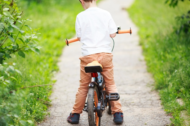 Boy with a bicycle on the street