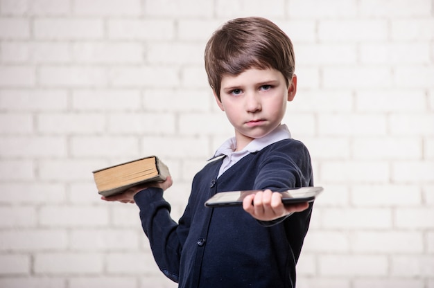 Boy with a book on a white background