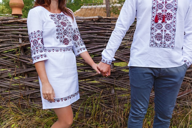 Boy with a girl in national ukrainian clothes holding hands