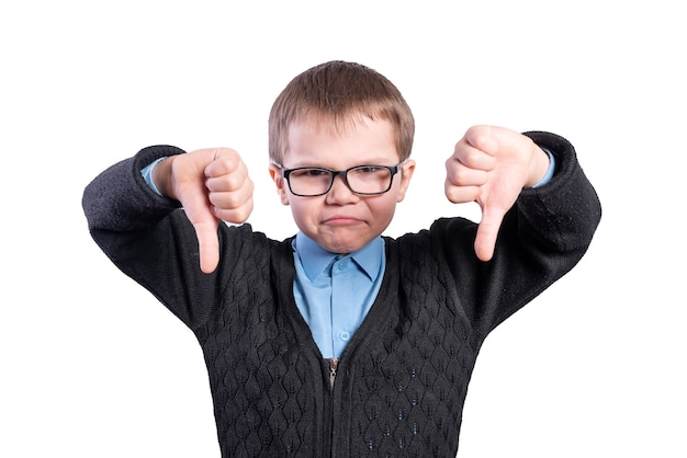 Boy with glasses shows thumbs down. isolated on white background. high quality photo