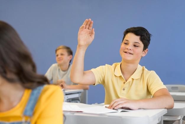 Boy with hand raised