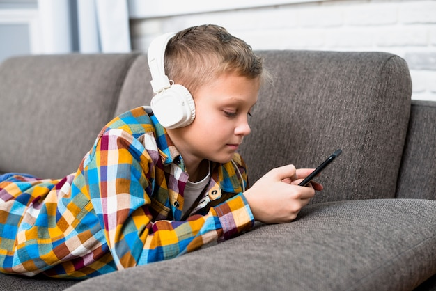 Boy with headphones using smartphone