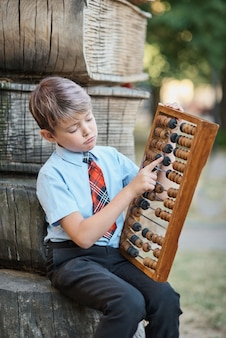 Boy with large abacus