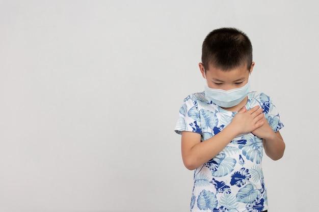 Boy with mask posing on white background
