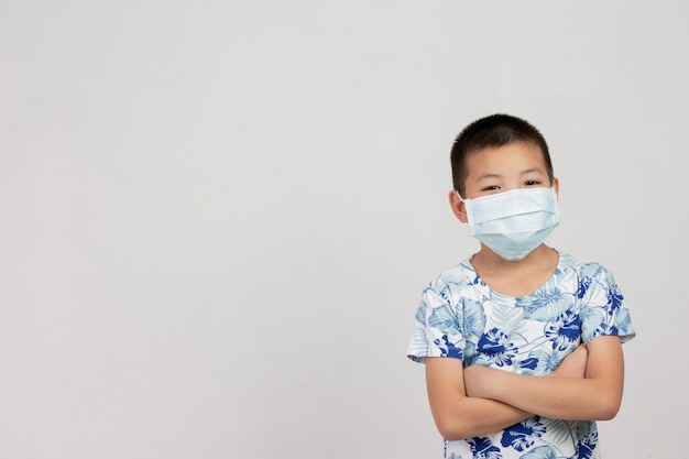 Boy with mask standing